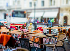 treet view of a Cafe terrace with tables and chairs,paris France